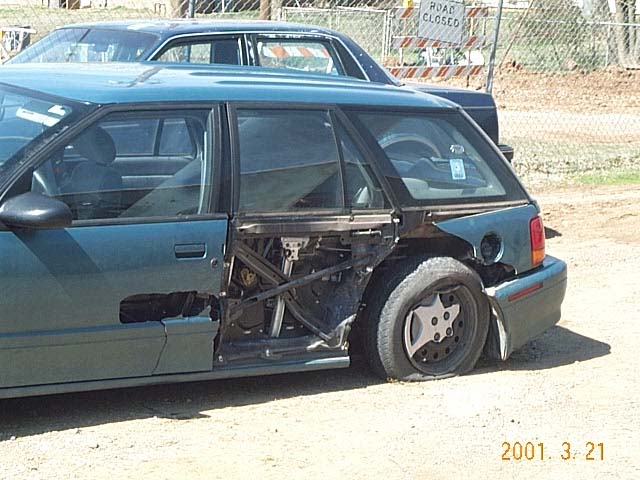 View of damage, standing just left of the drivers side door